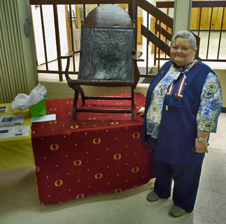 Historian Jayne Blair, The speaker, president of the Board of Directors of the James Madison Museum of Orange County Heritage, poses with James Madison's Compeche chair, which she brought to the club's March 13 program at the LOW Clubhouse.